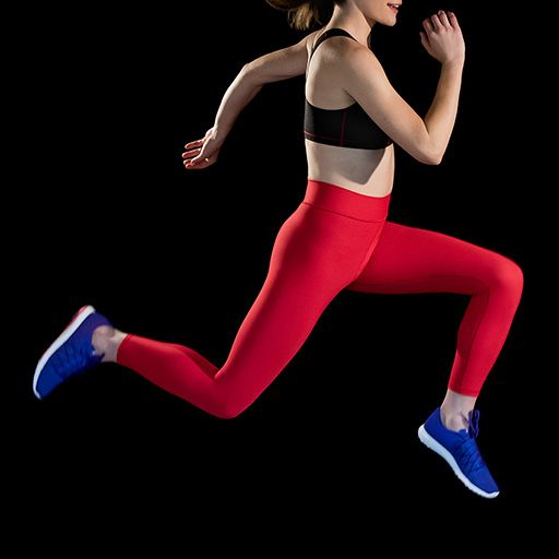 Photograph of woman in Marena Sport garments jumping on a black background